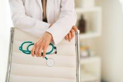 Closeup on medical doctor holding stethoscope Stock Image