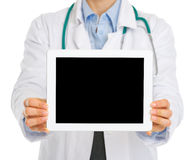 Closeup on medical doctor holding tablet PC Stock Image