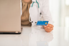 Closeup on medical doctor woman with credit card Stock Photo
