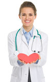 Closeup on medical doctor woman giving paper heart Royalty Free Stock Photography