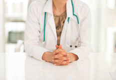 Closeup on medical doctor woman sitting in office Royalty Free Stock Photography