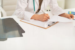 Closeup on medical doctor woman working in office Stock Image
