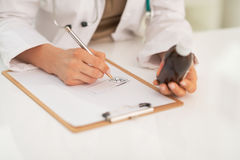 Closeup on medical doctor writing prescription Royalty Free Stock Images
