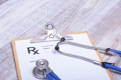 Closeup of medical stethoscope on a rx prescription.  Royalty Free Stock Image