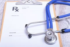 Closeup of medical stethoscope on a rx prescription.  Stock Photography