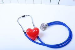 Closeup of medical stethoscope on a rx prescription, red heart on white background royalty free stock photos