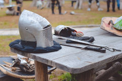 Closeup of medieval armors on old wooden table in Stock Photography