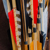 Closeup Medieval set of old wooden arrows with bright plumage Royalty Free Stock Photo