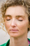 Closeup Meditation. Blond Mature Woman With Curly Hair Closeup Portrait When Meditating Stock Photography