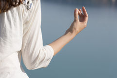 Closeup of a meditation pose by a woman stock photography
