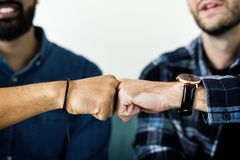 Closeup of men fist bumping royalty free stock photos