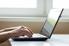 Closeup of men with laptop Stock Photo