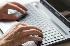 Closeup of men with laptop Stock Images