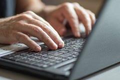 Closeup of men with laptop Royalty Free Stock Photo