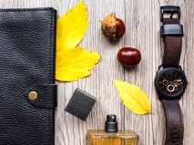 Closeup of men`s accessories and essential items on wooden background. Flat lay, top view, view from above Stock Images