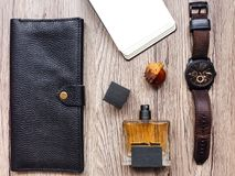 Closeup of men`s accessories and essential items on wooden background. Flat lay, top view, view from above Royalty Free Stock Photography