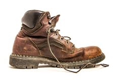 Closeup of Men`s Dirty Beat Up Brown Leather Work Boots Isolated on White Background Stock Images