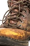 Closeup of Men`s Dirty Grungy Worn Out Brown Leather Work Boots Isolated on White royalty free stock photos