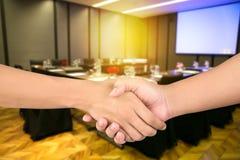 Closeup men's handshaking Stock Photos