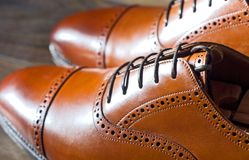 Men`s leather oxford shoes. Closeup of men`s high quality oxford shoes Royalty Free Stock Photography