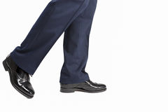 Closeup of Men's Stylish Semi-Brogue Oxford Shoes on a Walking M. An. Against White. Horizontal Image Royalty Free Stock Photography