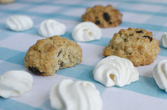 Closeup of meringue and cookies on a blue tablecloth Royalty Free Stock Photo
