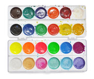 Closeup of messy, used water-color paint-box. Royalty Free Stock Images