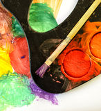 Closeup of messy, used water-color paint-box and paint brush Royalty Free Stock Photos