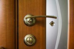 Closeup of metal bronze doorknob Stock Photos