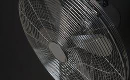 Closeup metal fan on black background Stock Photo