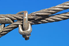 Closeup of metal fasteners and steel wire rope .  clamp Stock Image