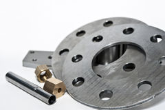 Closeup metal flanges and brass nuts. CNC milling/lathe Stock Photography