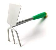 Closeup of metal gardening rake and shovel Stock Photo