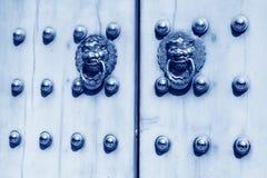 Metal Knocker on the door in the Forbidden City in Beijing, chin. Closeup of metal knocker on the door, in the Forbidden City in Beijing, china, blue picture Stock Photo