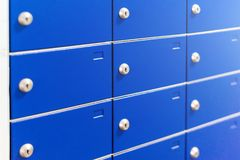Closeup of metal safe deposit boxes. Outdoor parcel lockers for private delivery. Blue mailboxes. Closeup of metal safe deposit boxes. Outdoor parcel lockers Stock Images