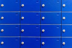 Closeup of metal safe deposit boxes. Outdoor parcel lockers for private delivery. Blue mailboxes. Closeup of metal safe deposit boxes. Outdoor parcel lockers Stock Image