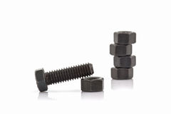 Closeup metal screw, bolt and metal nuts. Royalty Free Stock Images