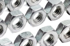 Closeup metal screw (bolt) and nuts on white background. Stock Photos