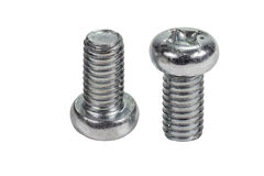 Closeup metal screw (bolt) and nuts on white background. Royalty Free Stock Image