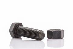 Closeup metal screw, bolt and nuts. Closeup metal screw, bolt and nuts on white background Stock Photos