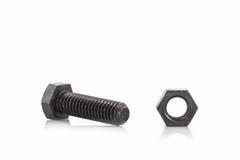 Closeup metal screw, bolt and nuts. Closeup metal screw, bolt and nuts on white background Royalty Free Stock Photo