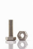 Closeup metal screw and nuts. Royalty Free Stock Photo