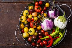Closeup of  metallic basket with fresh vegetables. Closeup of metallic basket with fresh vegetables- tomatoes, eggplants and peppers Stock Photography