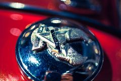 Closeup of metallic sign Of a eagle at motorbike Royalty Free Stock Images