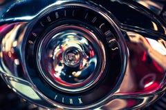 Closeup of metallic sign at a motorbike Royalty Free Stock Photo