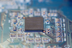 Closeup of microchip. Closeup of electronic circuit board with processor royalty free stock photo