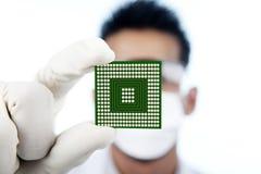 Closeup of microchip computer. Scientist showing a microchip computer, shot in studio royalty free stock photos