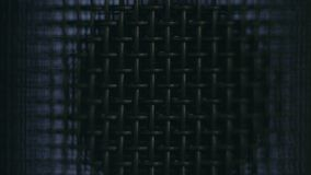Closeup microphone metallic mesh in changing light Royalty Free Stock Photography