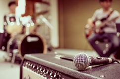 Closeup of microphone on musician blurred background Stock Image