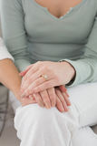 Closeup mid section of female friends touching hands Royalty Free Stock Photo